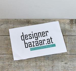 <span>Designer Bazaar</span><i>→</i>