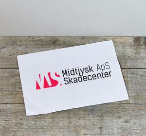 <span>Midtjysk Skadecenter</span><i>→</i>