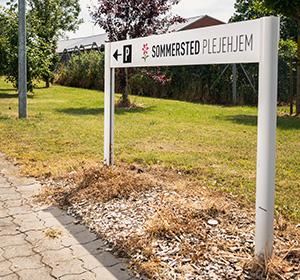 <span>Sommersted Plejehjem</span><i>→</i>
